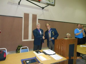 Lou Monteforte passing the gavel over to John Clary